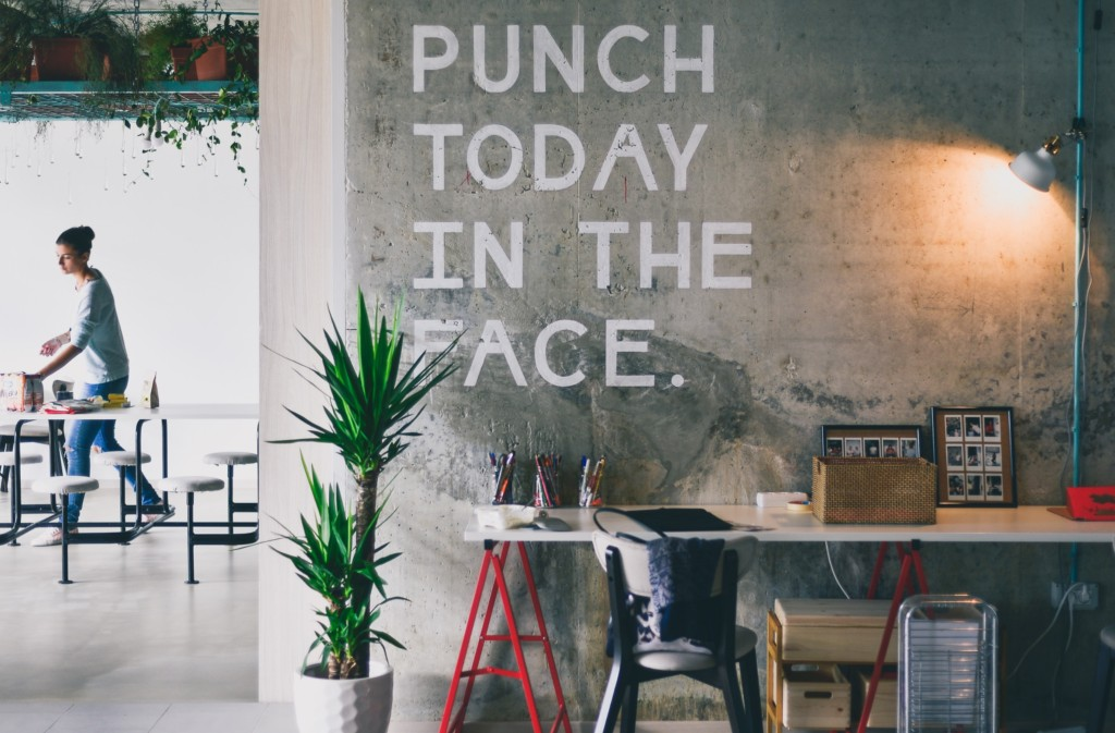 This is a photograph of an office wall that says, 'Punch today in the face'. It's representative of stress.