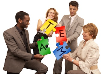 """Team solving a puzzle that says """"team""""."""